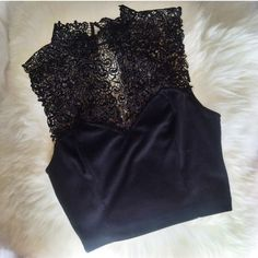 Urban Outfitters high neck lace top This is black With lace détail towards the neck. This is cropped and looks great With high waisted pants or à skirt. This is a medium. Urban Outfitters Tops Crop Tops