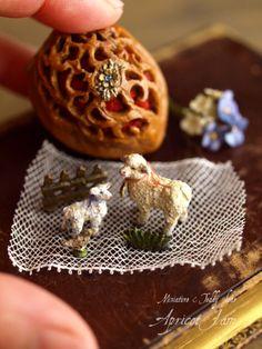 Walnut glove with sheep set inside.