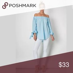 Light Blue Off Shoulder Tunic Tie Sleeve Blouse The top you'll definitely want to add to your collection - it's so versatile!! Featuring a cotton/spandex blended blouse with elastic stretchy band that creates a sexy off the shoulder look. Flowly boho style with hi lo hemline. Long sleeves with cute ties at the end that can be easily adjusted.   Pair with your favorite jeans, leggings, skirts or work pants for a versatile look!   Made of: 95% Cotton & 5% Spandex Tops Blouses