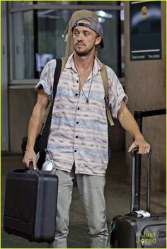 JustJaredJR Tom Felton arrives back at the airport with all his instruments over the weekend in Vancouver, Canada.