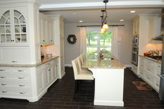 """This custom kitchen was built in the """"G"""" residence, beautiful white custom cabinets and dark floors make this kitchen standout! Visit http://www.turnberrycustomhomes.com/ to turn your dream kitchen into a reality!"""