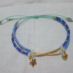 Pulsera Doble azul Materiales: Accesorios en oro goldfield, hilo,  murano, mostacillas checas Valor: $12.000