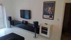 IKEA Besta wall-mounted AV cabinet with in-progress photos.