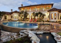 Neo-Mediterranean homes. Red tile roofs, stucco walls, archways, towers and heavy wooden doors with a Spanish or Tuscan flavor.  Why It's Appealing: The Southern European style and materials work well in warmer climates and match the landscape.