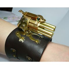 A Steampunk Wrist Gatling Gun For The Ladies Winextra ❤ liked on Polyvore featuring weapons, steampunk, jewelry and bracelets