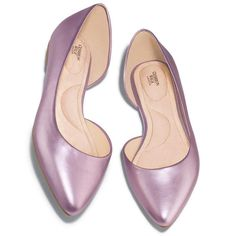 These soft metallic leatherlike flats are an absolute vision in violet featuring a pointed toe and an asymmetrical D'orsay pattern on the inside of the shoe. Regularly $29.99, buy Avon Fashion products online at http://eseagren.avonrepresentative.com