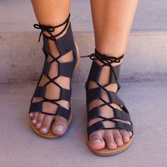 If you love 'em so much, why don't you marry 'em? You'll want to be joined in holy matrimony to these Marielle Lace Up Sandals in black! Featuring a matte leather material with a caged, strappy front