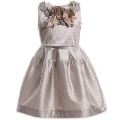 <span>I Pinco Pallino girls beige sleeveless dress with a soft satin shine and all over grey floral pattern with a velvet feel. It has pale pink trims and a gorgeous grey and beige grosgrain ribbon rosette front with large crystal gems. The comfortable silky soft lining has stiff tulle netting stripes, creating a full and structured shape, perfect for special occasions.<br /></span> <ul> <li>Dress: 43% acetate, 51% polyamide, 6% elastane (looks and feels like satin)</li> <li>Lining: 62%…