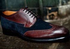 """The Finsbury Balmoral Brogue blends calf scotch grain leather with fine calf suede for a look that can best be described as """"elegant patchwork."""" The indulgent materials and intense colors - rich mahogany and deep blue – make for a striking design that's a more daring alternative to a traditional brogue. (Price: £450.00 BUY)"""