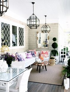 I love this porch!! such a great idea for an outside space! Of course I also love the woodwork on the window panes.
