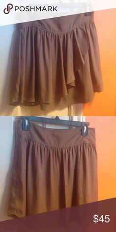 BCBGeneration Skirt Dark taupe skirt from BCBGeneration with lining. Both the skirt and lining are 100% polyester. Has zipper down the side. Ruffle flap detail in front (pic 3). Barely been worn-like new! BCBGeneration Skirts Midi