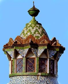 Finca Güell's ceramic and brick  tower.  Finca Guell is the stables and porter's lodge for Guell Estate in Barcelona, Spain
