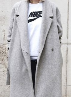 Nike shirt + a sleek gray jacket. Casual chic.