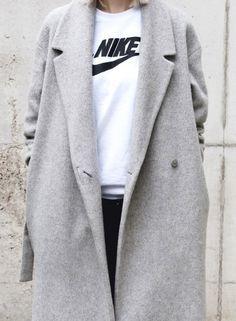 Nike shirt + a sleek gray jacket. Casual chic.