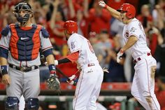 Reds rally to beat the Braves - Michael Lorenzen (right) of the Cincinnati Reds celebrates after scoring the game-winning run as Atlanta Braves catcher A.J. Pierzynski (left) walks away during the ninth inning of a game on May 12 in Cincinnati. The Reds won 4-3. - © John Minchillo/AP Photo