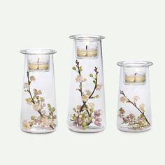 I am loving the simplicity of this symmetry trio!  Add some PartyLite votives and personal touches like these blossoms and wa-la!  Instant ambiance.