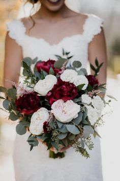 Amazing bridal bouquet of burgundy peonies, blush garden roses and seeded eucalyptus. Floral V Designs in Bellbrook Ohio.