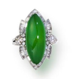 A jadeite and diamond ring set in platinum.cabochon jade, measuring approximately 23.0 x 18.7mm.,Sold for US$ 86,500 (BGN 151,646) inc. premium