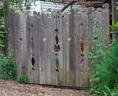 Fence with decorative cutouts and fancy top.  Can you say fresh jigsaw blade?!?