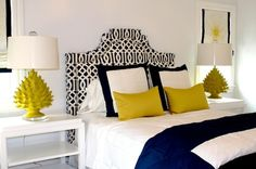 navy and white bedroom with yellow accent