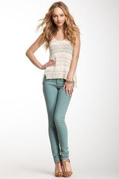 Grey striped sleeveless t-shirt. Light blue jeans. Brown studded heels.