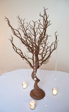 Manzanita trees with optional gem drops.  Uniquely Yours Wedding Design