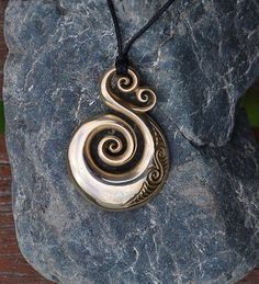 Solid Bronze Koru Pendant on black cord or antique by JackieTump Jewelery, Jewelry Necklaces, Necklace Ideas, Maori Designs, Filigree Design, Bone Carving, Fantasy Jewelry, Metal Clay, Or Antique