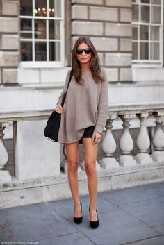 neutral over-sized sweater and black shorts