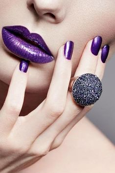 Purple makeup. Luscious purple lips and purple fingernails.