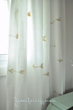 How to make custom gold arrow curtains from hand-carved stamps, and gold fabric paint.