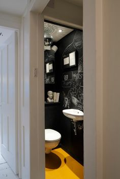 Chalkboard paint on the downstairs loo with a yellow rubber floor, image by James Balston for www.madaboutthehouse.com