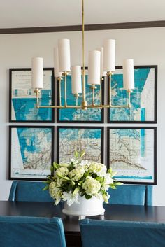 teal chairs + gold mod chandy map art. Slice up some large wall maps or nautical charts and frame them.  Rent-Direct.com - No Fee Apartment Rentals in NY.
