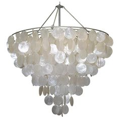 Available in three distinct sizes, the Serena Chandelier is fun, dramatic, and inviting! Dainty round capiz shells offer subtle movement and provide a soft, natural glow. It is sure to be noticed and make a statement in any room.