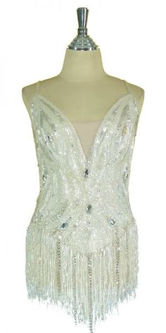 This one piece leotard is made to the highest quality and standard possible. The bodice uses tear-drop Swarovski crystals and scattered 8mm Swarovski stones. Silver beading and 6mm cupped sequins in fishscale adorn the base of the bodice. The hanging fringe is densely made in small faceted beads and diamante strands. Available to buy online here - http://www.sequinqueen.com/product.php?productid=2332=96=1