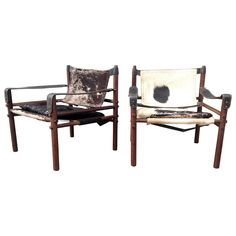 Pair of Arne Norell Sirocco Chairs in Rosewood and Cow Hide | From a unique collection of antique and modern chairs at https://www.1stdibs.com/furniture/seating/chairs/