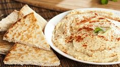Fermented black garlic and slow cooker caramelized onions create a sweet and savory hummus created with homemade tahini. Vegetarian Snacks, Vegan Appetizers, Appetizer Recipes, What Is Hummus, Slow Cooker Caramelized Onions, Clean Recipes, Cooking Recipes, Homemade Tahini, Homemade Hummus