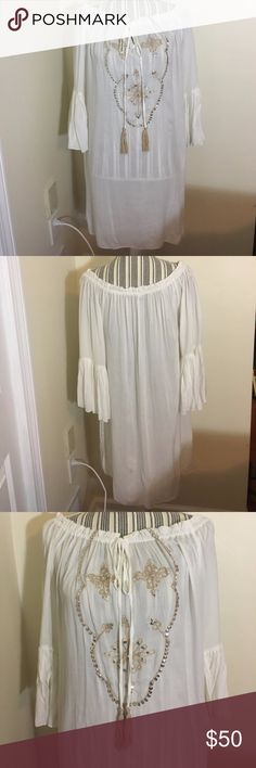 NWOT Beautiful Boho White Loose Festival Dress Brand new never worn, I bought it at a fashion trade show but never ended up wearing it so it's new without tags. This beautiful piece was handmade in Indonesia and makes the perfect dress for a coverup on the beach, or outfit for a festival or concert. It could also be worn as a tunic over leggings for a date or just casual wear. It is one Size. Because of how it's supposed to look I believe it fits a S-L best but it does also look great on an…