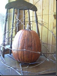 old chair, pumpkin and some vine