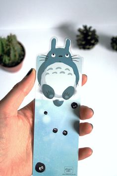 Totoro shaped bookmark illustrated by ChezGermaineCaillou on Etsy