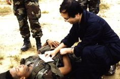 "Triaging battlefield casualties in Saudi Arabia during operation ""Desert Storm"", 2nd February 1991."