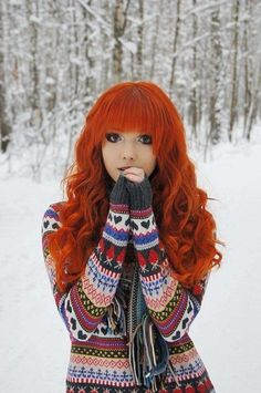 long red hair, also love the sweater, and her eyes! and the back ground! so much love for this!!