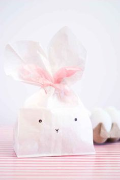 Give your Easter guests an extra treat to take home with paper bunny favor bags!
