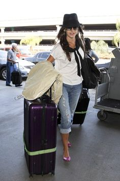 Actress Camilla Belle uses a large, purple Rimowa suitcase.