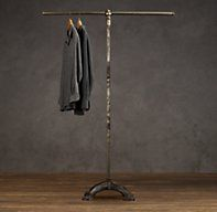 Mercantile Coat Rack - RH's Mercantile Coat Rack:Inspired by a mercantile antique originally from a clothing store, this coat rack eschews the conventional hooks in favor of a roomy bar. The design allows coats to be hung neatly and separately from hangers – and offers ample space to hook umbrellas, too.