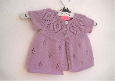 A pretty baby & girls cardigan with a gorgeous lace yoke. Knit in one piece seamlessly from the top down with a pretty diamond lace pattern. Worked in DK weightyarn.This pattern includes the instructions to knit 7 sizes from preemie up to 6 years and also includes the instructions to knit the cardi with cap sleeves, short sleeves (pictured) and long sleeves giving you plenty of options to suit all climates not to mention amazing value for money.