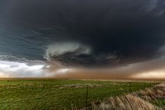 Earth Mover - Red dirt gets pushed around in a big Texas supercell. Photography by Sean Ramsey