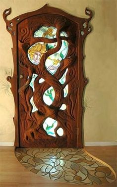 Carved and stained glass door. Most awesome door ever and I want it. I think I'll opt for plain ol' clear or frosted glass over stained glass though--the door is beautiful on its own. Cool Doors, The Doors, Unique Doors, Windows And Doors, Entry Doors, Art Nouveau, Door Knockers, Door Knobs, Tree Carving