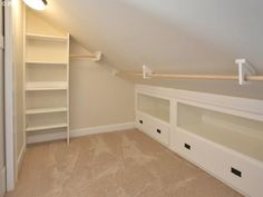 B's closet - close off storage w/ wall, large sliding doors(??) to access storage space; pole; shelves @ both ends