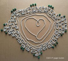 white beads and green metal screws   2/20/17