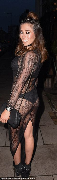 Racy: Her knickers and bra were merely covered by a very sheer black lace dress which had a split running up the back